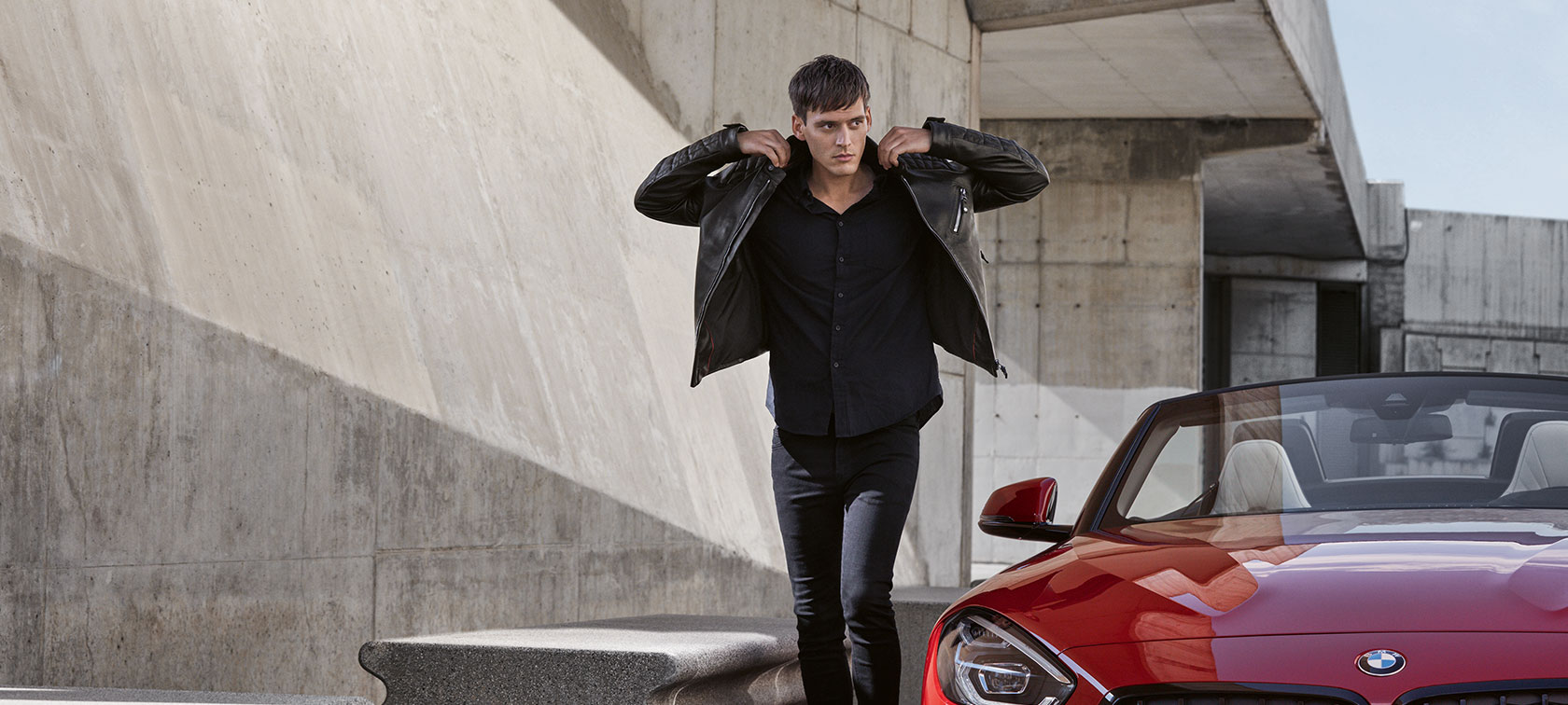 A man is shown wearing a BMW Men's Leather Jacket from the BMW Collection.